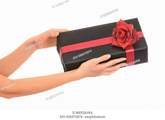 woman giving a black box with red rose as a gift