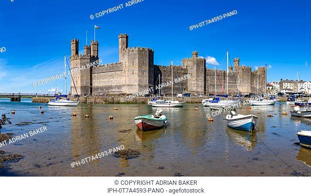 Caernarfon Gwynedd Wales May 12, 2019 Caernarfon castle, on the estuary of the river Seiont where it enters the Menai Strait