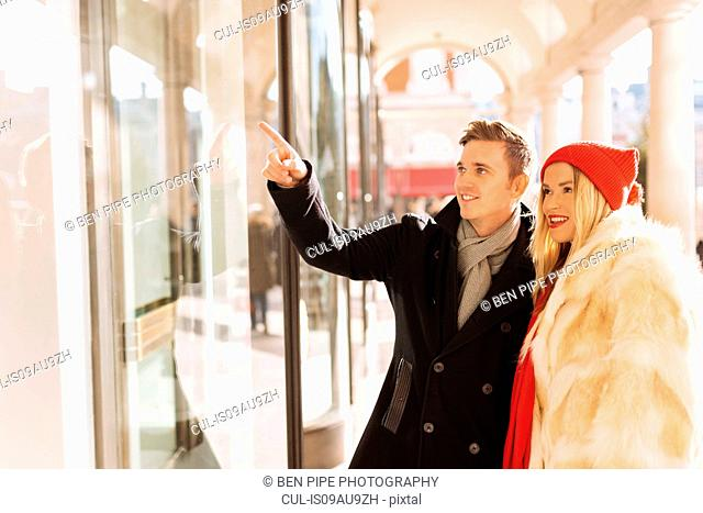 Young couple window shopping in Covent Garden, London, UK