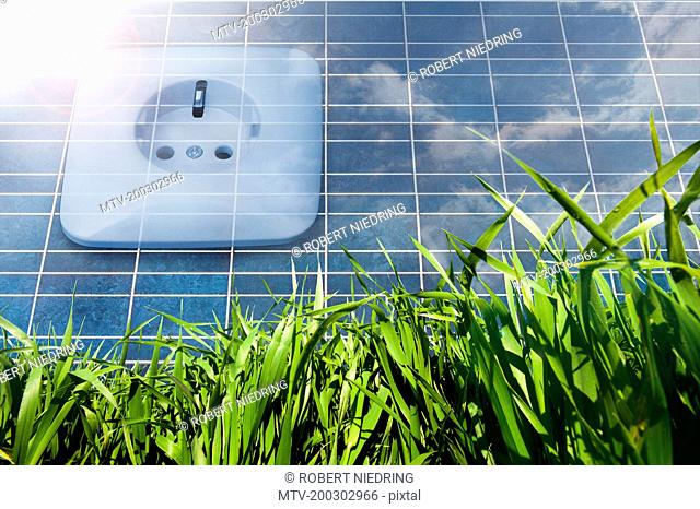 Solar panel with power socket representing environmental conservation, Bavaria, Germany