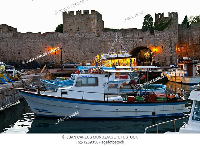 Fishing boats and walls at the commercial port, City of Rhodes, Rhodes Island, Dodecanese, Greece, Mediterranean Sea