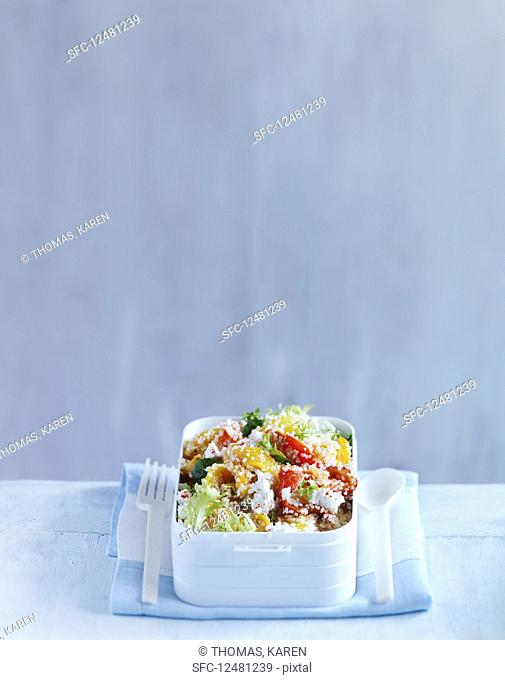 Couscous salad with peppers and feta in a lunch box
