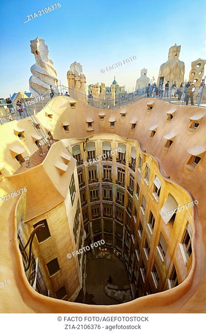 View of the roof and the courtyards of Casa Mila, known as La Pedrera, designed by architect Antoni Gaudi. Barcelona, Catalonia, Spain