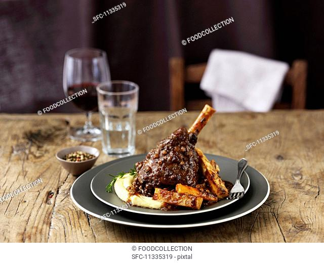 Lamb shank with mashed potatoes, parsnips, gravy and wine