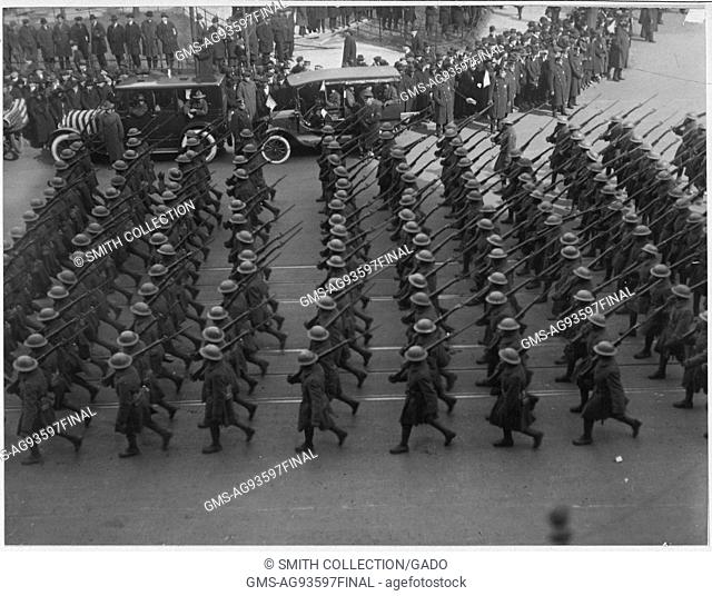 During a large parade honoring the return of the brave and heroic African American troops of the 369th Infantry, the old 15th of New York City