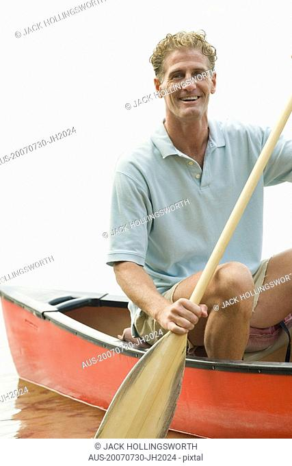 Mature man canoeing in a river