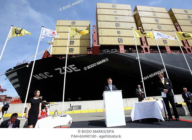 Pierfrancesco Vago (C), Executive Chairman of MSC Cruises and board member of the MSC Group, speaks during the christening ceremony of 'MSCZoe' in Hamburg