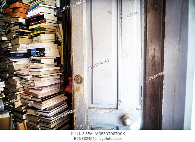 Books piled in a house room. Madrid, Spain, Europe