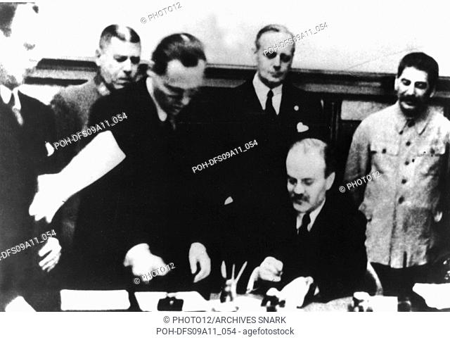 Signature of the German-Soviet nonagression pact in Moscow - August 23, 1939. Molotov is signing. Behind him, Ribbentrop and Stalin USSR, WWII