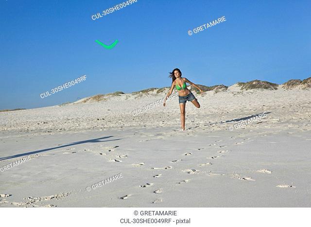Girl throwing boomerang