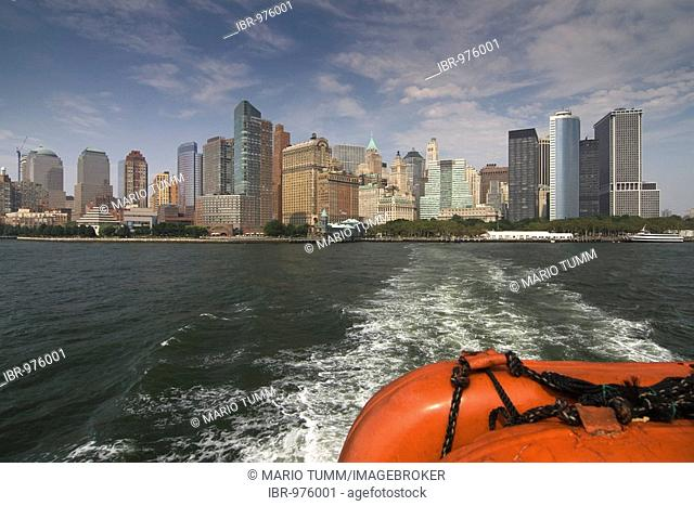Rescue buoys and the skyline of Manhattan from a ferry heading towards Liberty Island, New York, USA