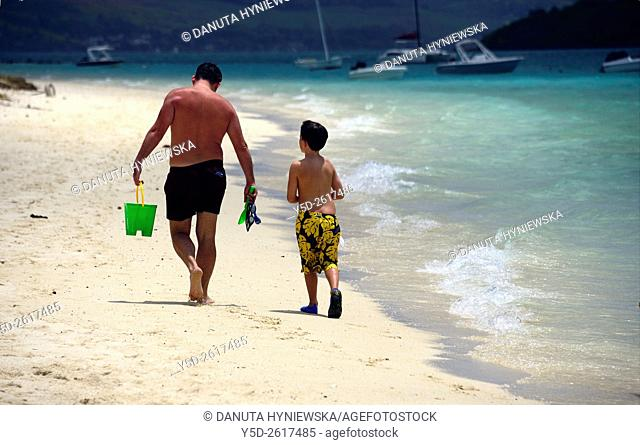 Young father with his little son walking at the seaside, Pointe d'Esny beach, Grand Port District, Southeastern coast of Mauritius, Mascarene, Mascarene Islands