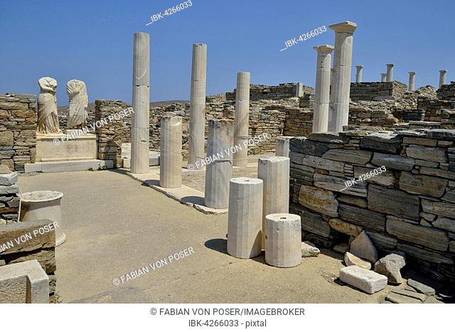 Ancient statues and columns, Cleopatra and Dioscorides, torsos with no heads, Delos island, UNESCO World Heritage Site, Mykonos, Cyclades, Greece