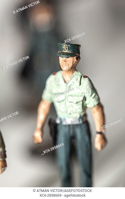 Tiny miniature vintage civil guard figurine standing