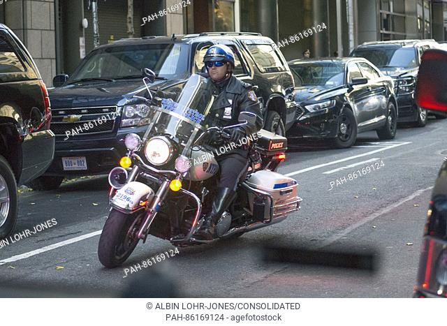 A NYPD motorcycle leads the motorcade for President-elect Trump as he travels from Trump Tower to Laguardia Airport for a series of visits to Indianapolis and...