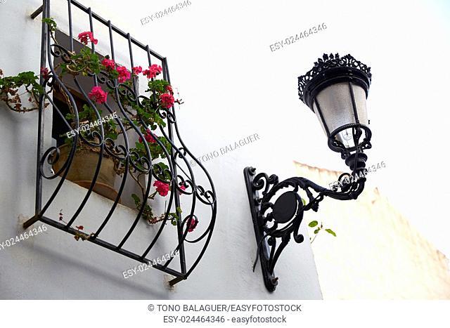 Benidorm white facade window with flowers pot and streetlight Mediterranean