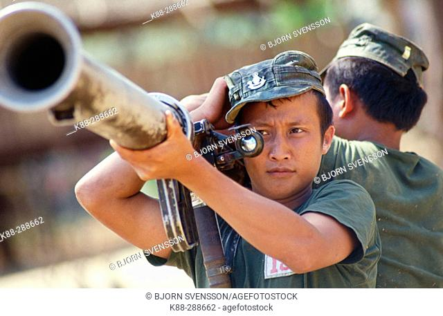 Officer cadets during weapon training with a grenade launcher. KNLA (Karen National Liberation Army) headquarter. Kawthoolei (Karen State)