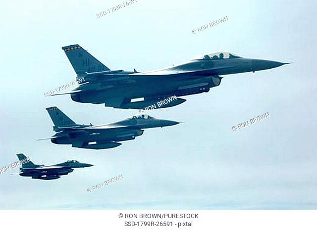 Three F-16 fighter jets flying in a formation
