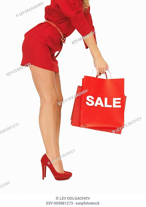 closeup picture of woman on high heels holding shopping bag