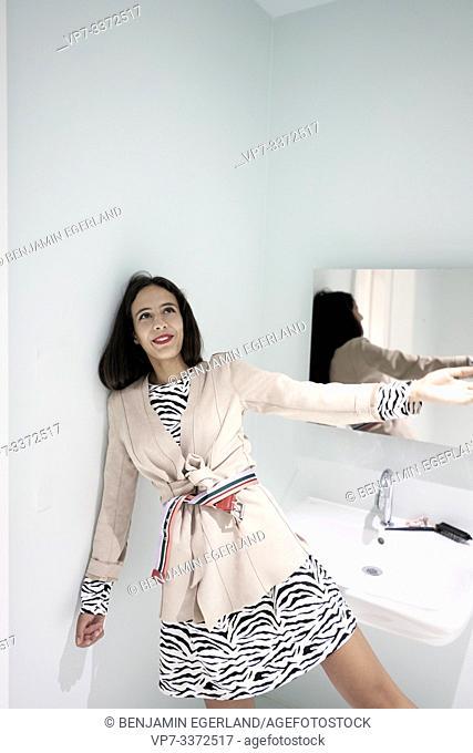 carefree stylish woman in bathroom