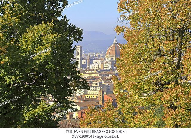The Duomo and Giotto's Bell Tower seen through autumnal trees from Via di San Miniato al Monte, Florence, Tuscany, Italy, Europe