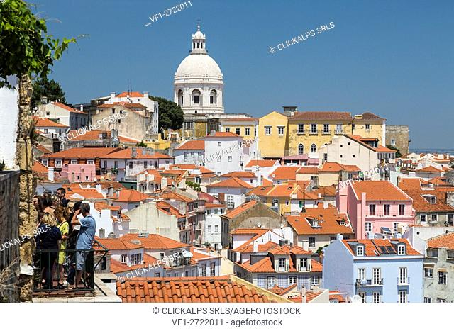 Terracotta roofs and the ancient dome seen from Miradouro Alfama one of the many viewpoints of Lisbon Portugal Europe