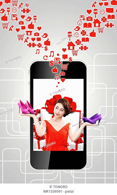 a woman standing in a smart phone holding heels