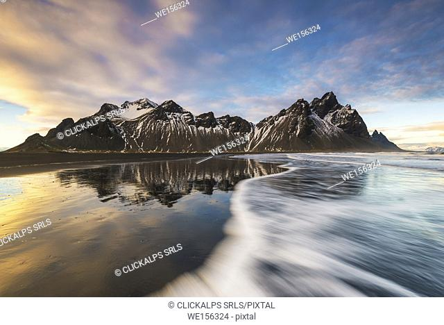 Stokksnes, Hofn, East Iceland, Iceland. Vestrahorn mountain reflected on the shore at sunset