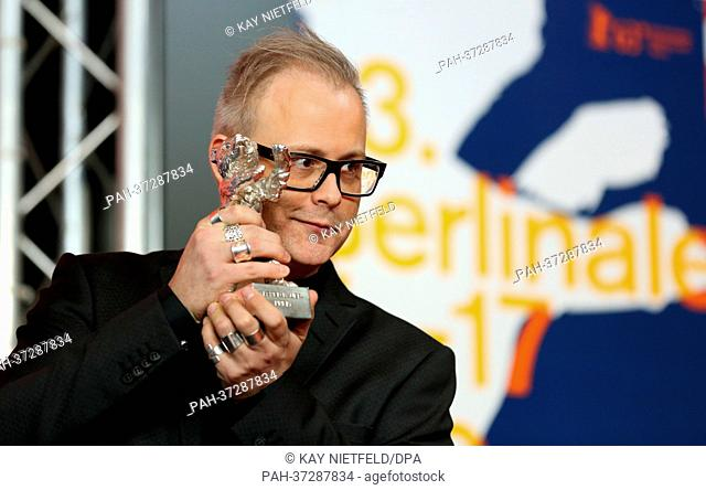 Canadian director Denis Cote poses with the Silver Bear - Alfred Bauer Prize in memory of the Festival Founder for a feature film that opens new perspectives...