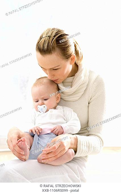 mum with baby on her knees