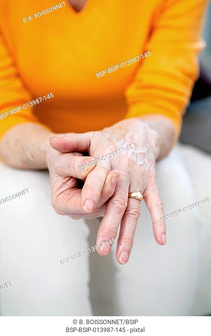 Senior woman with hand pain