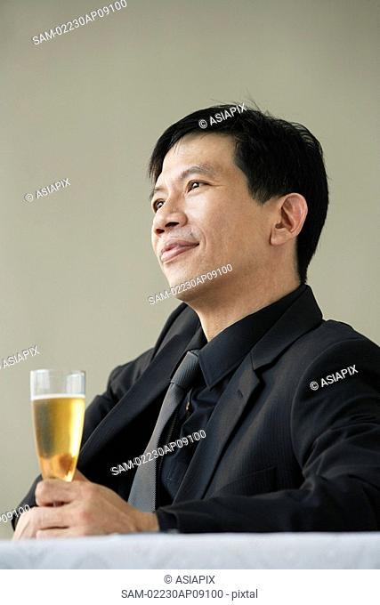 Man enjoying glass of champagne