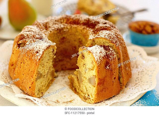 Pear and walnut Bundt cake, slices cut