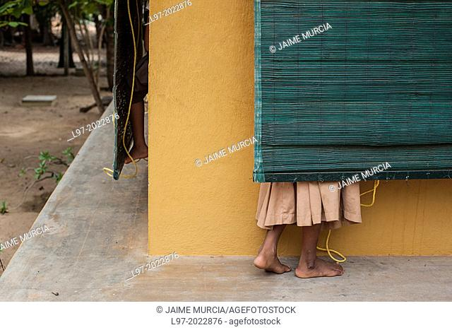 Indian children's feet and window blinds, India