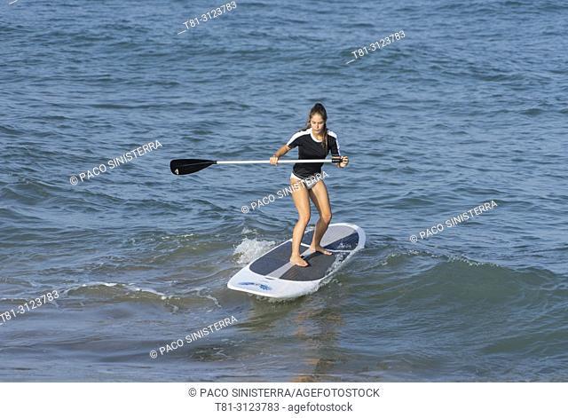 girl doing paddle surfing, Alcocebre, Castellon, Spain