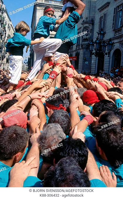 'Pinya',  foundation of a 'Castell' or Human Tower. Barcelona. Catalonia. Spain