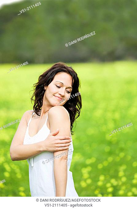 Brunette pretty woman in park smiling and feeling good