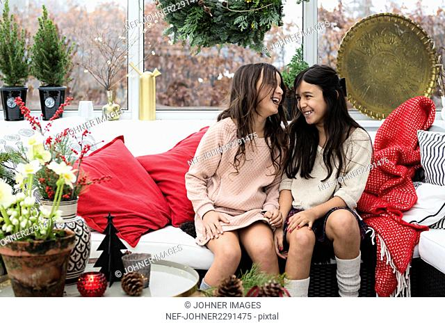 Two sisters giddy with Christmas excitement