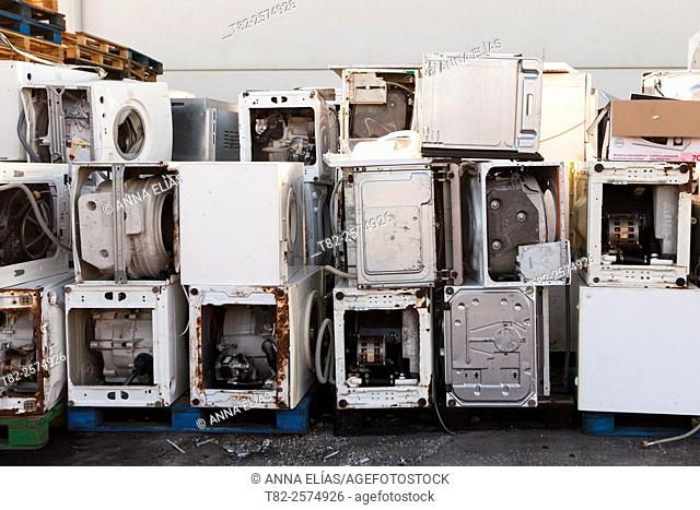 many washers stacked for recycling