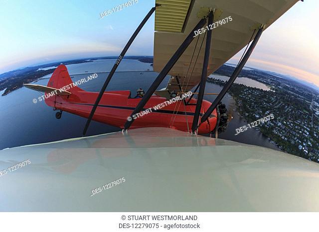 Wingtip view of Waco UPF-7 biplane; Puget Sound, Washington, United States of America