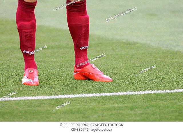 Footballer's legs and feet. Taken before the local derby between Real Betis and Sevilla FC which took place at Ruiz de Lopera stadium, Seville, Spain