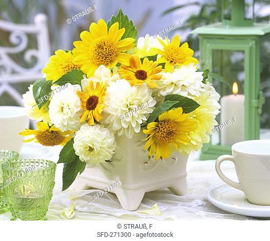 Arrangement of dahlias, marigolds and sunflowers
