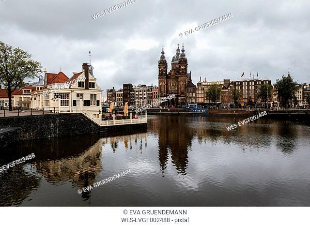 Netherlands, Amsterdam, View of Amstel and Sint-Nicolaaskerk