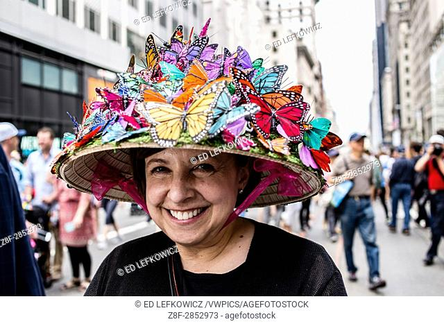 New York, NY - April 16, 2017. A woman wears a hat covered in brightly colored butterflies at New York's annual Easter Bonnet Parade and Festival on Fifth...