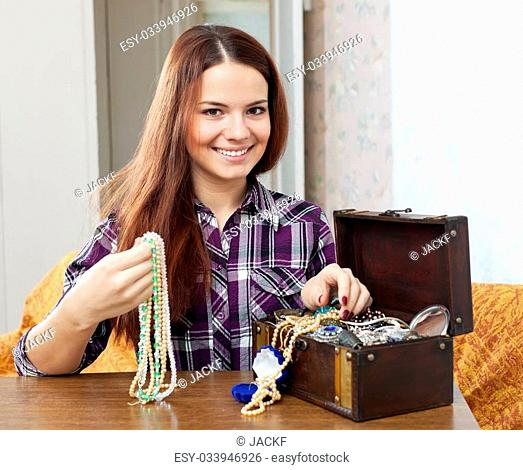 portrait of beautiful girl with treasure chest in home