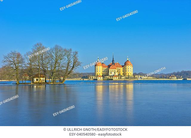View of wintery Chateau Schloss Moritzburg near Dresden, Saxony, Germany, with frozen lake