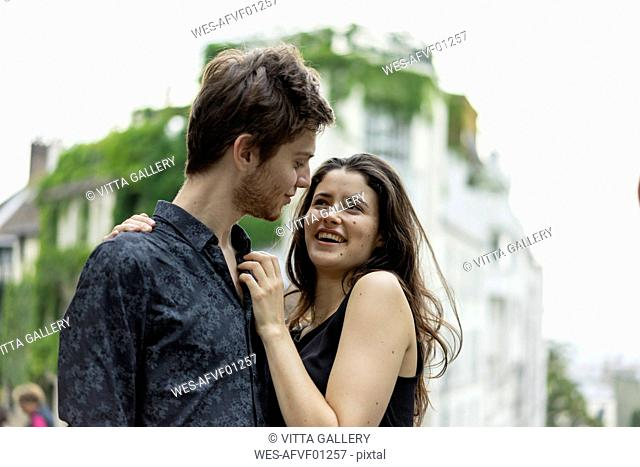France, Paris, happy young couple in love in the district Montmartre