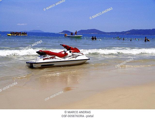 one parked jetsky on the beach shore