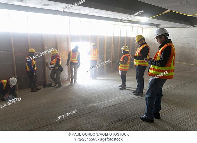 Seattle Washington: Members of the media retreat from the smoke as the cutterhead first breaches the retaining wall in the disassembly pit