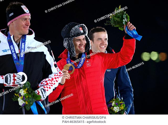 (L-R) Silver medalist Ivica Kostelic of Croatia, Gold medalist Sandro Viletta of Switzerland and Bronze medalist Christof Innerhofer of Italy pose with their...